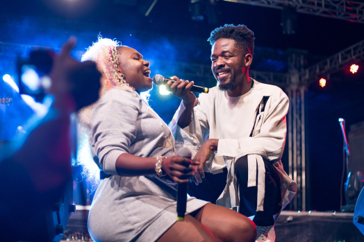 Johnny Drille & Niniola performing