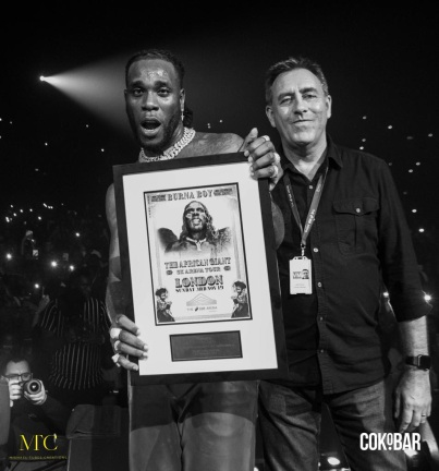 Burna Boy & CEO of Warner Music (Photo Credit: Michael Tubes Creations)